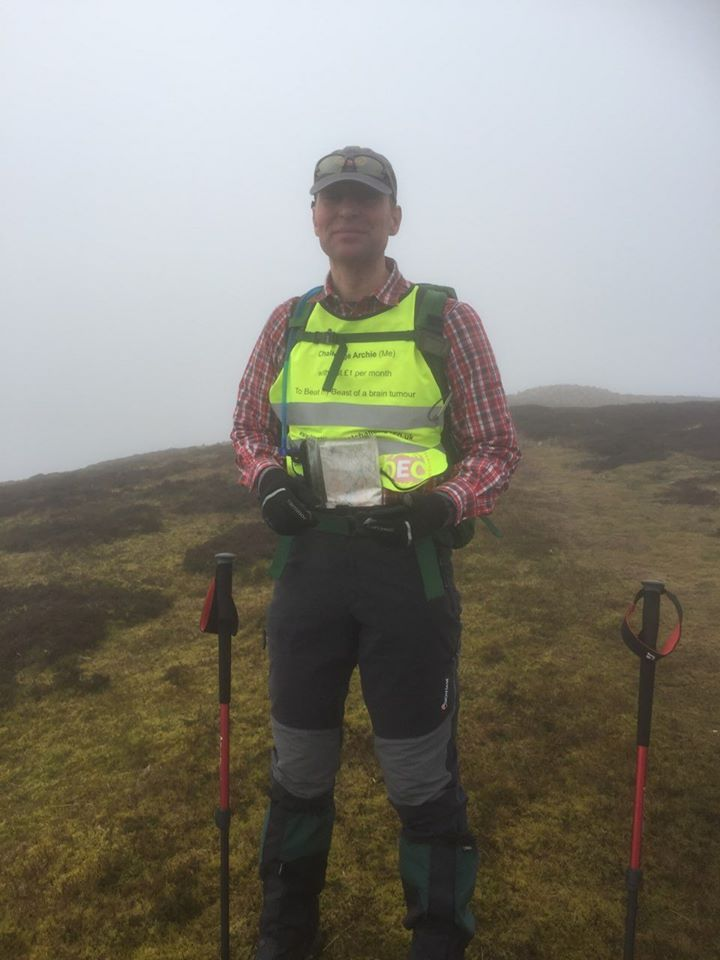 Posing on the mist covered Pentland hills